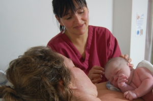 Claire with baby, and Lynda her midwife and friend